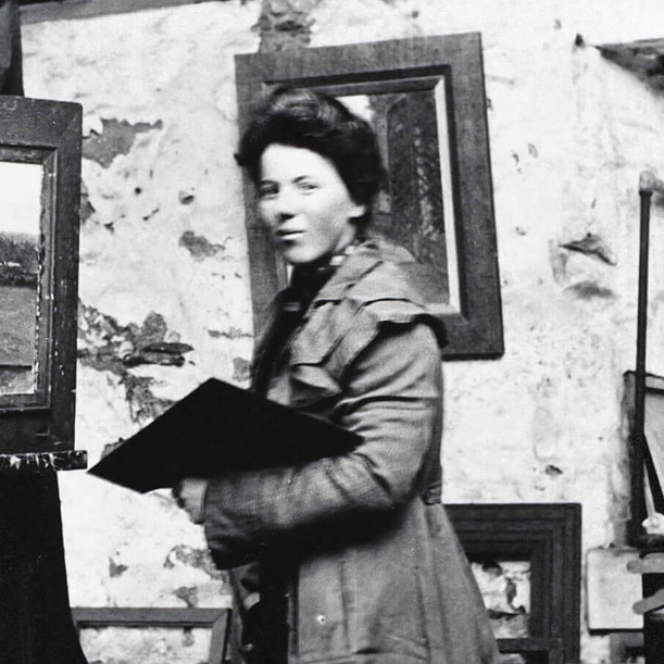 <p>Photograph of Helen McNicoll in her studio at St.Ives, c.1906, photographer unknown, Helen McNicoll artist file, The Robert McLaughlin Gallery, Oshawa.</p> <p></p> <p>Banner:Helen McNicoll,<em>The Apple Gatherer</em>, c.1911, oil on canvas, 106.8 x92.2cm, Art Gallery of Hamilton.</p>