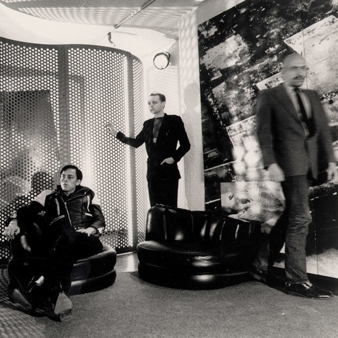 <p>General Idea relaxes in the installation<em>Reconstructing Futures</em>, 1977, installation, mixed media, overall 274 x432 x1,017cm, National Gallery of Canada, Ottawa, photograph by Jeremiah S. Chechik.<em>From left</em>: Felix Partz, AA Bronson, and Jorge Zontal.</p> <p></p> <p>Banner:General Idea,<em>Artist's Conception: Miss General Idea 1971</em>, 1971, screen print on salmon wove paper, 101.5 x66cm, edition of nine, signed and numbered, various collections.</p>