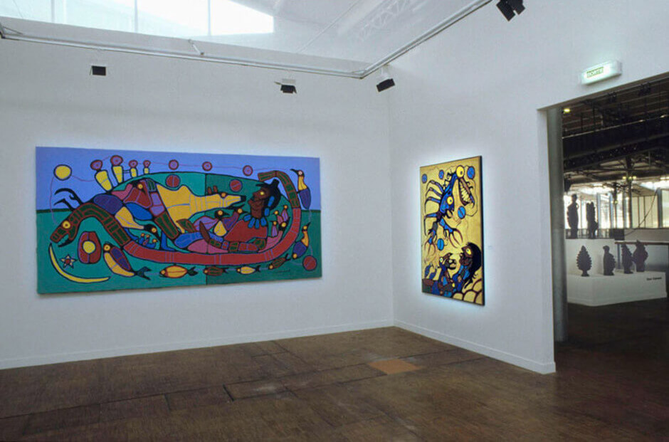 Art Canada Institute, Installation view of Norval Morrisseau's Untitled, n.d., and Artist With Thunderbird Vision (The Visionary), 1977