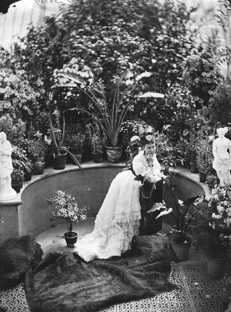 Art Canada Institute, William Notman, Mrs. MacKenzie in Allan's Conservatory, 1871