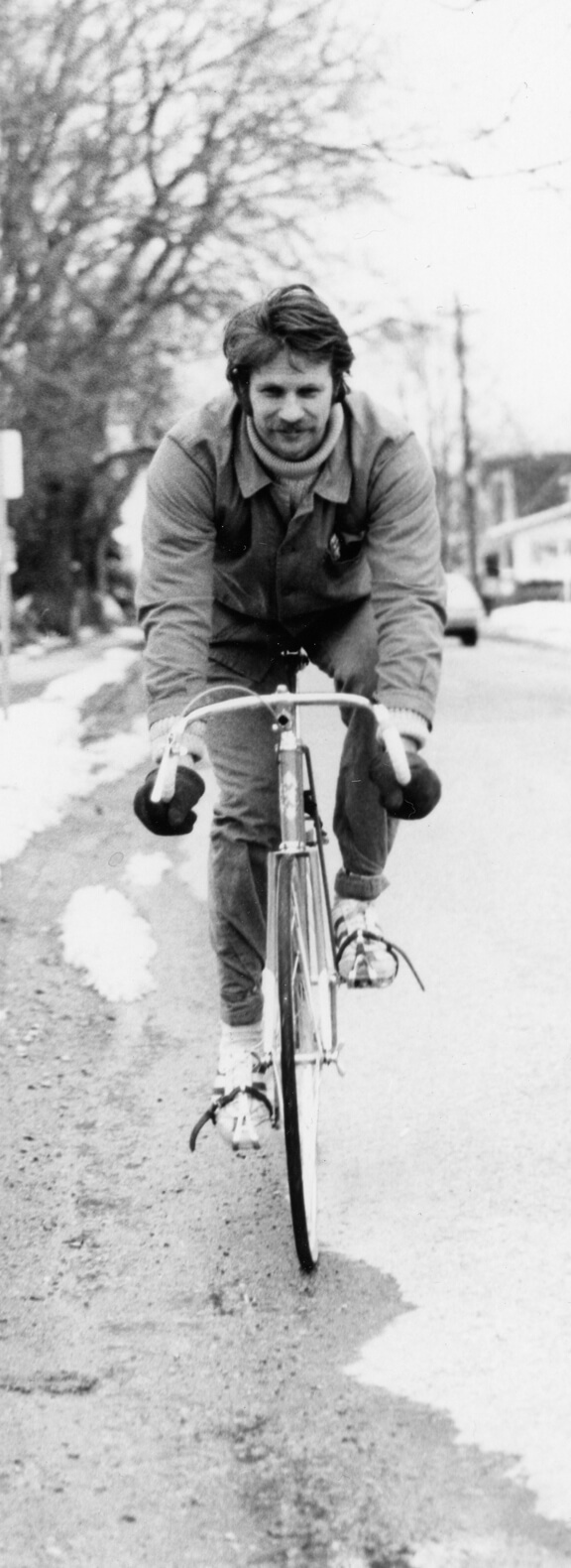 Art Canada Institute, Greg Curnoe, Greg Curnoe riding one of his bikes, c. 1974