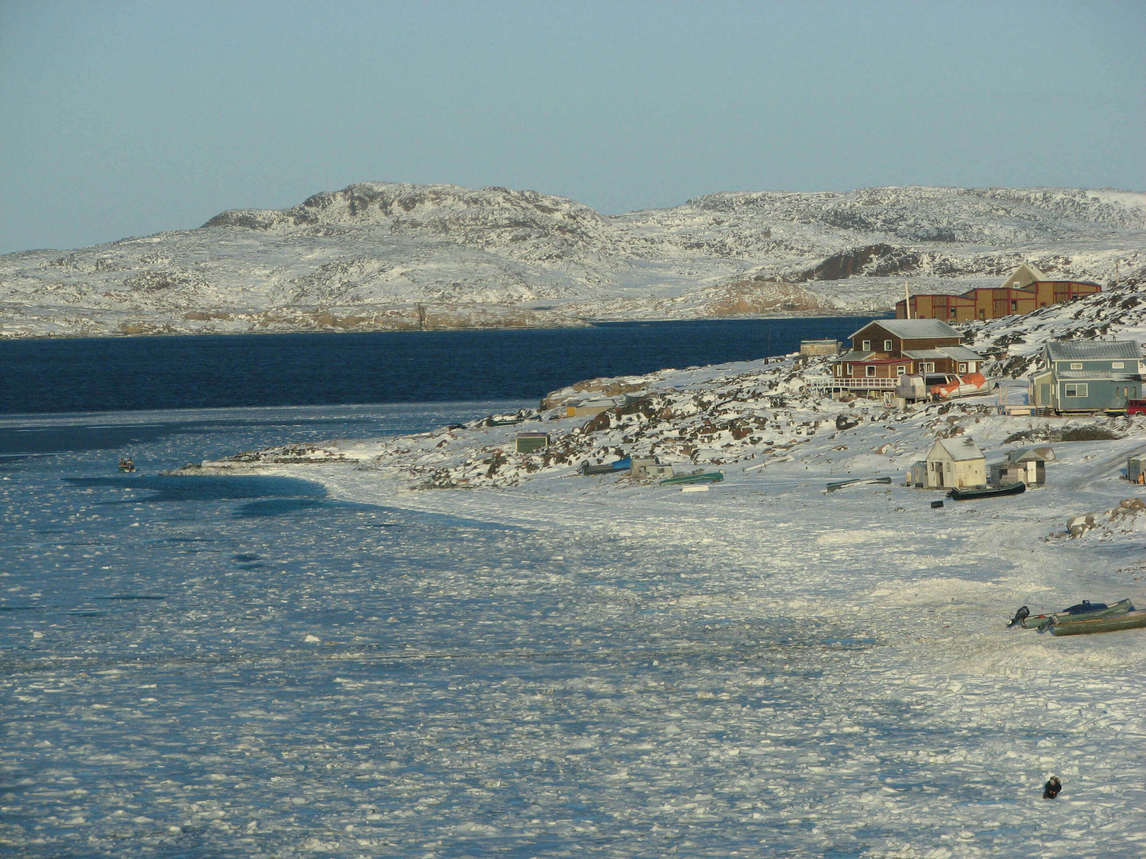 Art Canada Institute, Nancy Campbell, photograph of the community of Cape Dorset on the coast of Dorset Island, 2006
