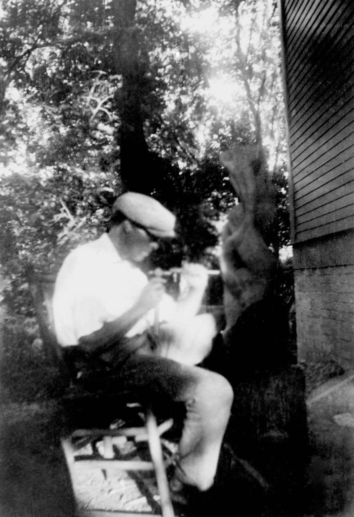 Art Canada Institute, photograph of Lionel LeMoine FitzGerald carving Untitled oak sculpture, 1936