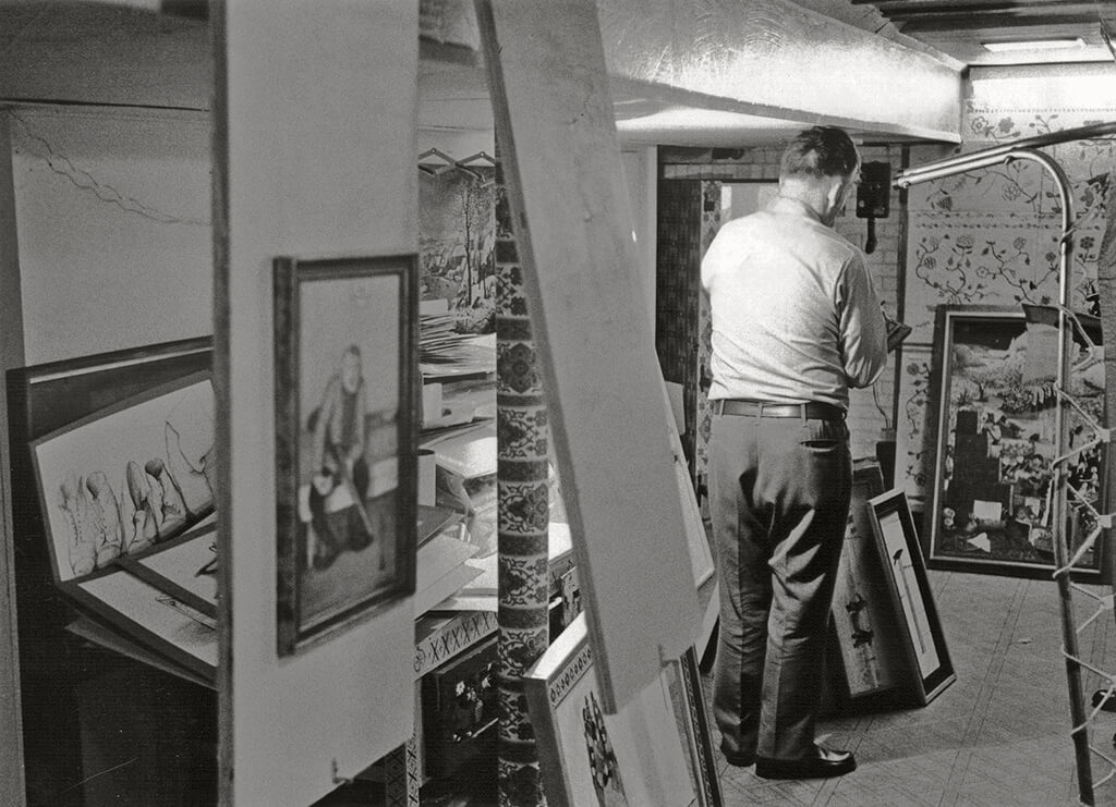 Art Canada Institute, William Kurelek, William Kurelek in the studio he built in the basement of his Toronto home on Balsam Avenue, c. late 1960s / early 1970s