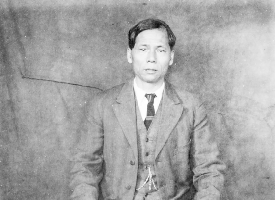 Chinese man in business suit and traditional Chinese shoes
