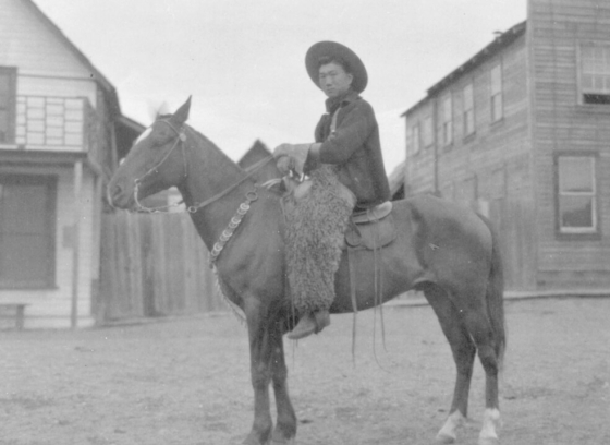 Kong Shing Sing on a horse on Barlow Avenue in Quesnel