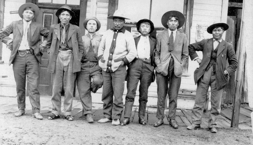 Group of men in front of C.D. Hoy's store in Quesnel